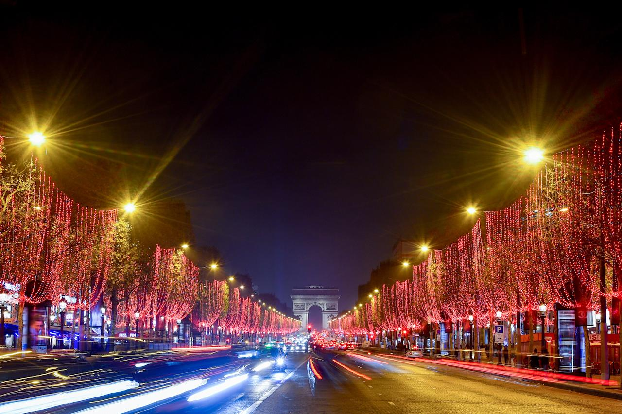 "For the second year, the most storied avenue in the capital has been done up in an eye-catching red hue for its annual holiday light installation. Aptly called Flamboyance, some 400 trees, running from the neon-hued Ferris wheel at the Place de la Concorde up to the <a href=""https://www.cntraveler.com/activities/paris/arc-de-triomphe?mbid=synd_yahoo_rss"">Arc de Triomphe</a>, are strung with shimmering LED lights, illuminating the entire avenue in red. It's so striking you'll hardly miss the avenue's <a href=""https://www.cntraveler.com/story/paris-ends-its-christmas-market-and-ferris-wheel?mbid=synd_yahoo_rss"">former Christmas market</a>, which has been moved down to the Tuileries Gardens through January 5, 2020. at the Christmas market, you'll not only find hundreds of wooden cabins selling small gifts and seasonal treats but a selection of stands run by French artisans, from glass blowers to woodworkers, and designers from the Paris Chamber of Commerce presenting their crafts."