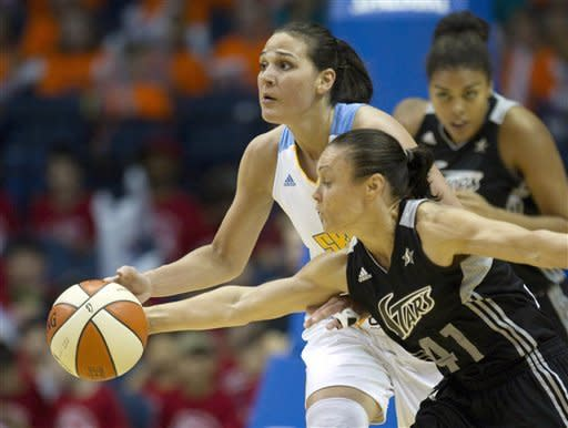 San Antonio Silver Stars' Tully Bevilaqua (41) steals the ball from Chicago Sky's Sonja Petrovic during the first half of an WNBA basketball game, Wednesday, July 11, 2012, in Rosemont, Ill. (AP Photo/Charles Rex Arbogast)