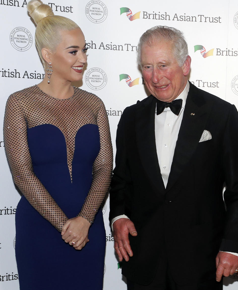 """Prince Charles met Katy Perry, left, at a reception for supporters of the British Asian Trust in London, in February 2020. The singer and the royal have shared interests in the charity sector and she called him a """"kind soul"""". (Kirsty Wigglesworth/AP)"""
