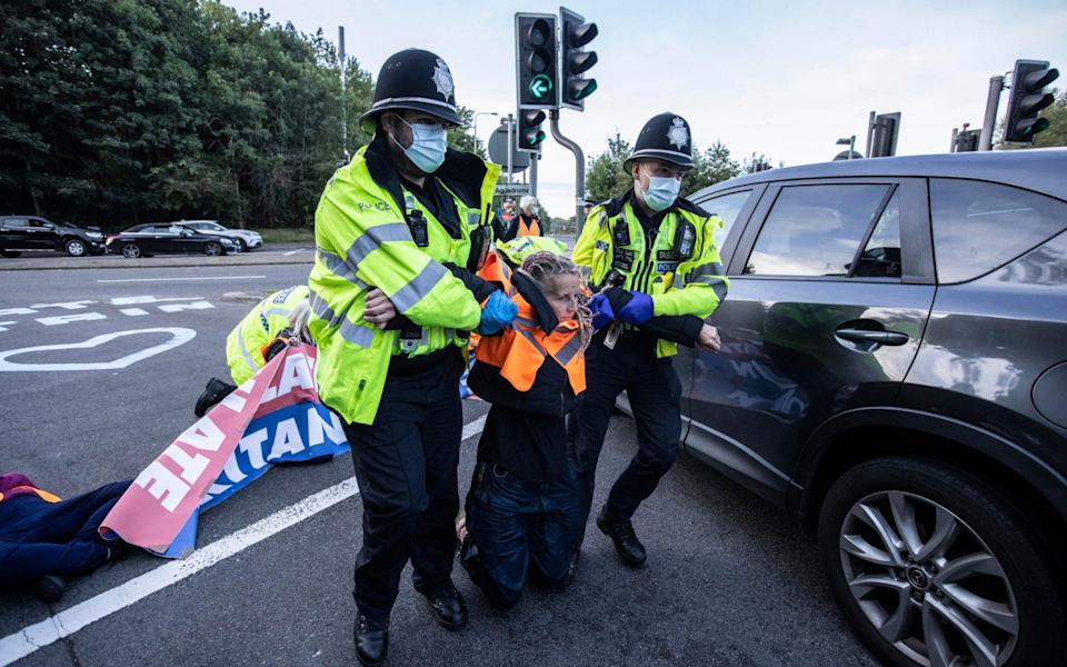 Police arrest climate change protesters who glued themselves to the road - Jeff Gilbert