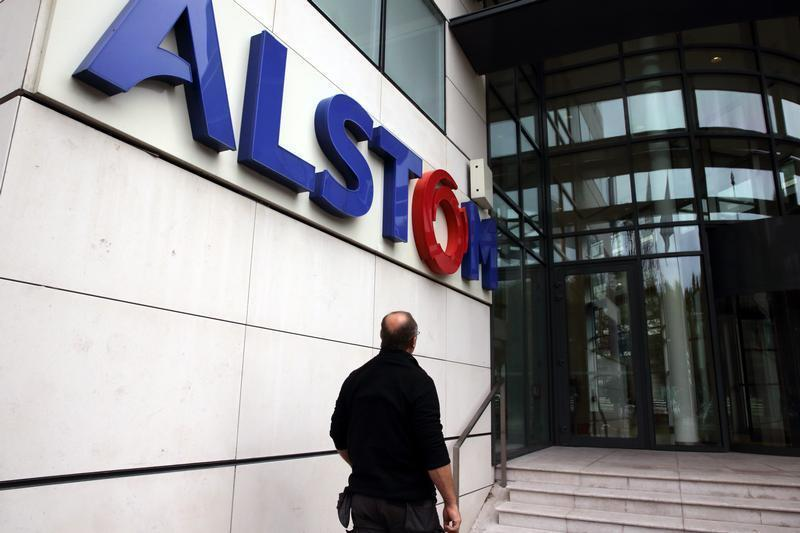 A man enters Alstom headquarters in Levallois-Perret