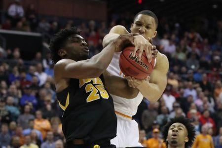 Mar 24, 2019; Columbus, OH, USA; Tennessee Volunteers forward Grant Williams (2) steals the ball from Iowa Hawkeyes forward Tyler Cook (25) in the second half in the second round of the 2019 NCAA Tournament at Nationwide Arena. Mandatory Credit: Kevin Jairaj-USA TODAY Sports