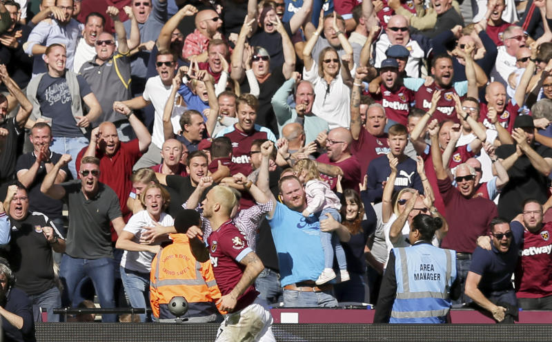 West Ham's Marko Arnautovic runs past fans to celebrate after scoring his sides third goal during the English Premier League soccer match between West Ham United and Manchester United at London Stadium in London in London England Saturday Sept. 29