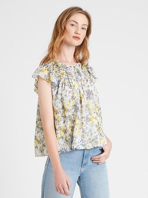 <p>This loose <span>Banana Republic Floral Smocked Blouse</span> ($24, originally $80) would look so nice with a slim skirt, too.</p>
