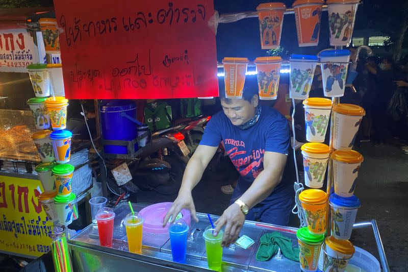 Thai drink seller, Komsan Moonsan is seen with his cart during an anti-government protest in Bangkok