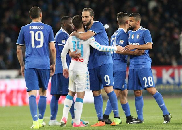 Juventus' forward Gonzalo Higuain greets Napoli's forward Dries Mertens at the end of an Italian Serie A football match on April 2, 2017 at the San Paolo Stadium (AFP Photo/CARLO HERMANN)
