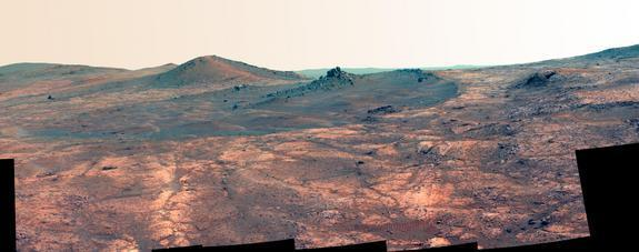 """View of """"Spirit of St. Louis"""" crater captured by NASA's Opportunity Mars rover on March 29 and March 30, 2015. This version of the image is presented in false color to highlight differences in surface materials."""