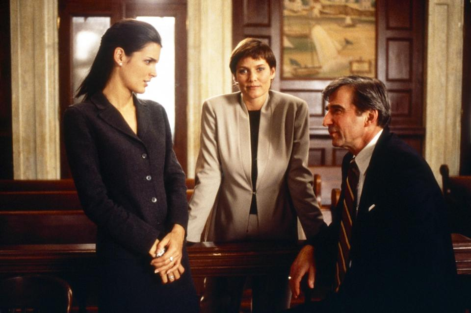 Angie Harmon, Carey Lowell, and Sam Waterstone in a courtroom