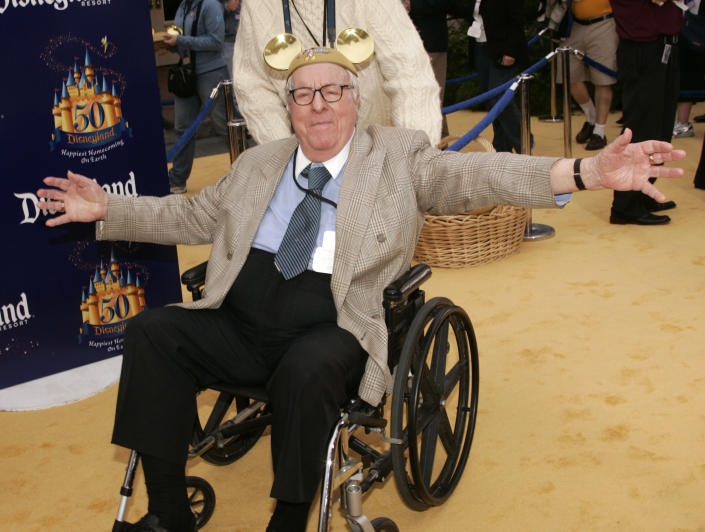 """Author Ray Bradbury, best know for his work """"Fahrenheit 451"""", poses during Disneyland's 50th anniversary party at the Disneyland theme park in Anaheim, California May 4, 2005. REUTERS/Fred Prouser"""