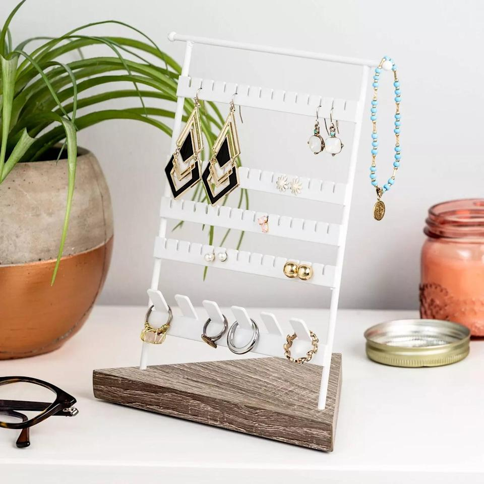 <p>Organize and display your gorgeous studs and hangings with the <span>Honey-Can-Do Geo No-Hassle Earring Stand Brown</span> ($20).</p>