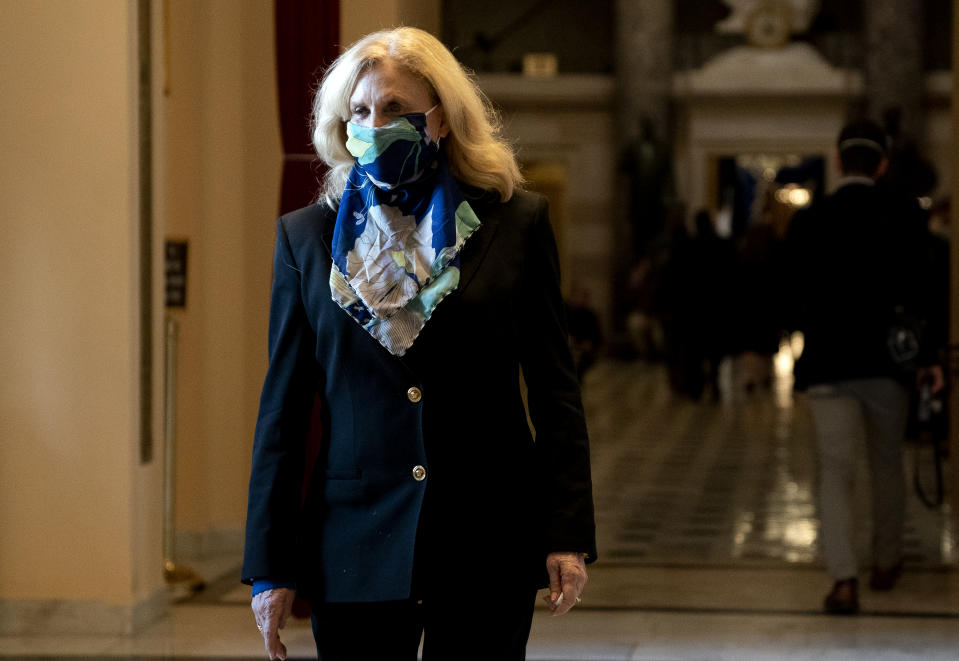 WASHINGTON, DC - JANUARY 13: Rep. Carolyn Maloney (D-NY) wears a protective mask while walking to the House Floor at the U.S. Capitol on January 13, 2021 in Washington, DC. The House of Representatives moved forward with impeachment following Vice President Mike Pences refusal to use the 25th amendment to remove Trump from office after protestors breached the U.S. Capitol last week. (Photo by Stefani Reynolds/Getty Images)