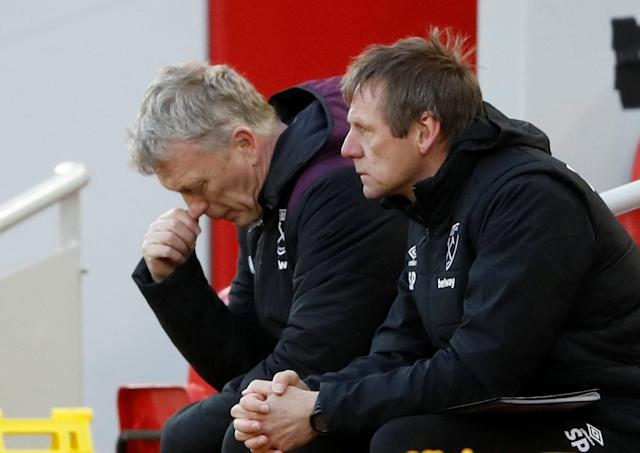 """Soccer Football - Premier League - Liverpool vs West Ham United - Anfield, Liverpool, Britain - February 24, 2018 West Ham United manager David Moyes and assistant manager Stuart Pearce Action Images via Reuters/Carl Recine EDITORIAL USE ONLY. No use with unauthorized audio, video, data, fixture lists, club/league logos or """"live"""" services. Online in-match use limited to 75 images, no video emulation. No use in betting, games or single club/league/player publications. Please contact your account representative for further details."""