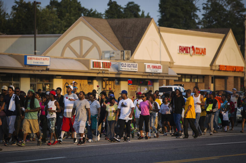 Demonstrators are seen during a peaceful march near Ferguson, Aug. 18, 2014. (Lucas Jackson / Reuters)