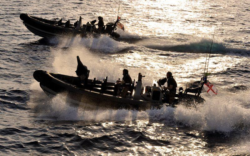 Having completed a successful ship boarding exercise, Royal Marines from Type 22 frigate HMS Cornwall leave the scene aboard the ship's Pacific 24 seaboats. - Credit: LA(Phot) Dave Jenkins/MoD
