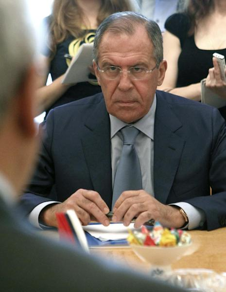 Russian Foreign Minister Sergey Lavrov meets with a delegation headed by a leader of the Syrian National Council (SNC), Abdulbaset Sieda, not pictured, in Moscow, Russia, Wednesday, July 11, 2012. (AP Photo/Misha Japaridze)