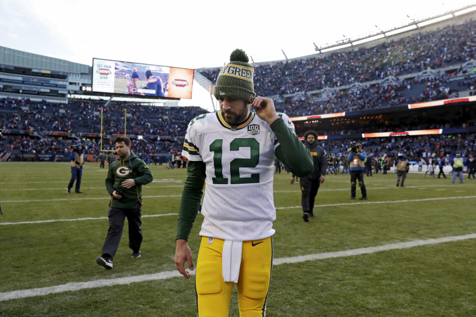 FILE - In this Sunday, Dec. 16, 2018, file photo, Green Bay Packers quarterback Aaron Rodgers walks off the field after a 24-17 loss to the Chicago Bears in an NFL football game in Chicago. Going into this weekend's game against the New York Jets, Rodgers' 61.8 percent completion rate was his lowest since his 60.7 rate in 2015, the year that then-top receiver Jordy Nelson was sidelined with a knee injury.  (AP Photo/Nam Y. Huh, File)