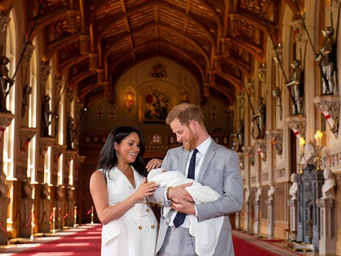 FILE PHOTO: Britain's Prince Harry and Meghan, Duchess of Sussex are seen with their baby son, who was born on Monday morning, during a photocall in St George's Hall at Windsor Castle, in Berkshire, Britain May 8, 2019. Dominic Lipinski/Pool via REUTERS