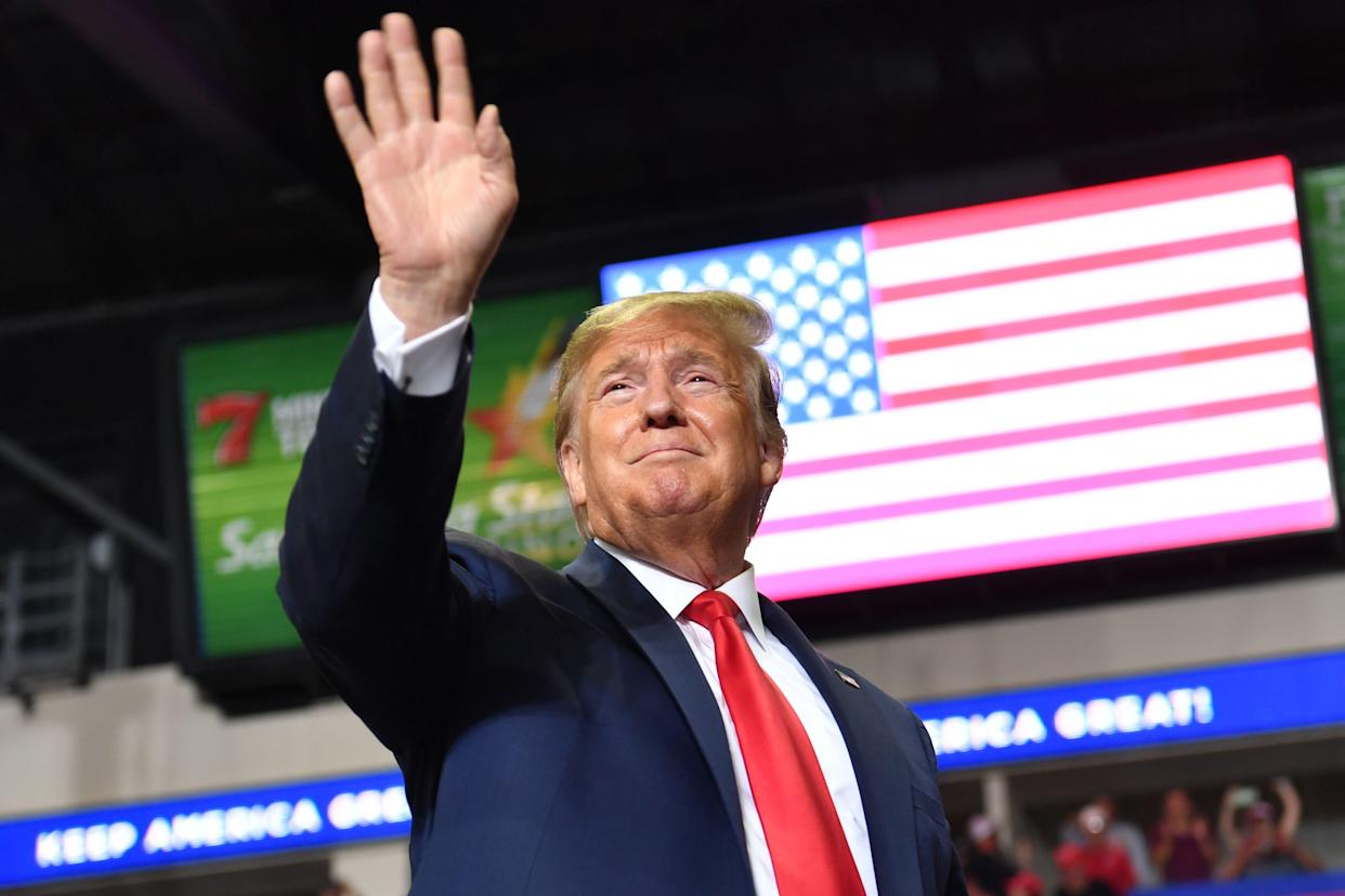 President Donald Trump waves to supporters as he arrives for a campaign rally in Rio Rancho, New Mexico, on Sept. 16, 2019.