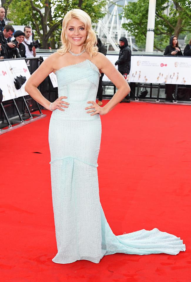 <p>At the BAFTA TV Awards, people began to notice a slimmer Holly with her figure looking less curvy in a mint Roland Mouret gown. <i>[Photo: Getty]</i> </p>