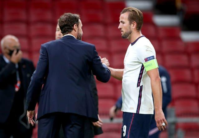 Southgate, left, is pleased at how Kane leads the England squad
