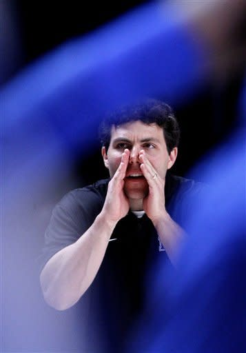 Memphis head coach Josh Pastner directs his team from the sideline in the second half of an NCAA college basketball game against the Northern Iowa at the Battle 4 Atlantis tournament Saturday, Nov. 24, 2012 in Paradise Island, Bahamas. Memphis won 52-47. (AP Photo/John Bazemore)