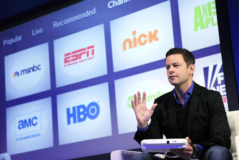 Zack Fountain, Nintendo's director of Network Business, discusses Nintendo TVii, Thursday, Sept. 13, 2012 in New York. Nintendo TVii collects all the ways users have to watch movies, TV shows and sports. This includes pay-TV accounts along with services such as Hulu and Netflix. The GamePad works as a fancy remote controller and will let viewers browse shows they can watch. (AP Photo/Mark Lennihan)