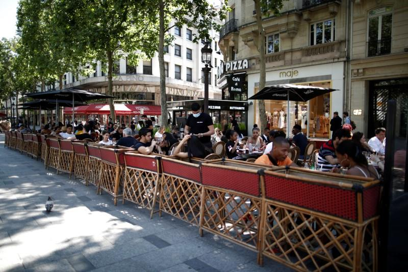 Outdoor seating only: Parisian cafes eke out space along sidewalks