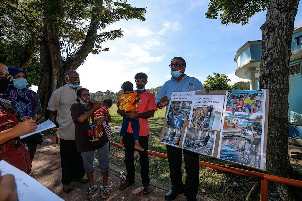 S. Ganesh (second from right) is is appealing for a public housing unit, having had to live out of his car after his house on Carnarvon Street caught fire in April. — Picture by Sayuti Zainudin