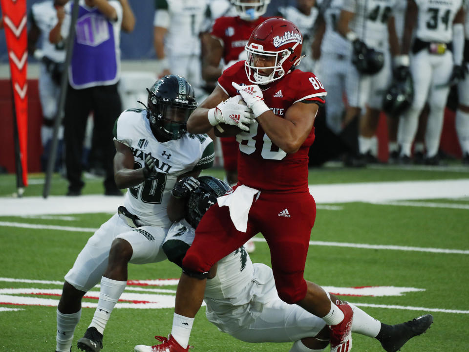 Fresno State tight end Juan Rodriguez runs in for a touchdown against Hawaii defensive back Cameron Lockridge, left, during the first half of an NCAA college football game in Fresno, Calif., Saturday, Oct. 24, 2020. (AP Photo/Gary Kazanjian)