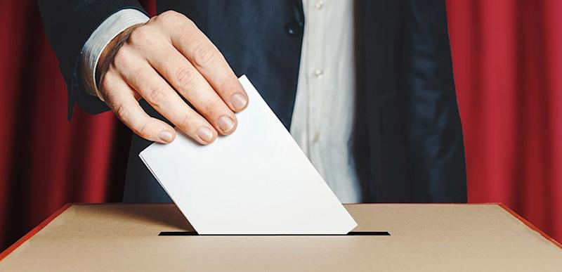 Man Voter Putting Ballot Into Voting box.