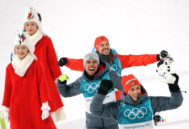 Nordic Combined Events - Pyeongchang 2018 Winter Olympics - Men's Individual 10 km Final - Alpensia Cross-Country Skiing Centre - Pyeongchang, South Korea - February 20, 2018 - Gold medalist Johannes Rydzek of Germany, silver medalist Fabian Riessle of Germany and bronze medalist Eric Frenzel of Germany celebrate during the victory ceremony. REUTERS/Carlos Barria