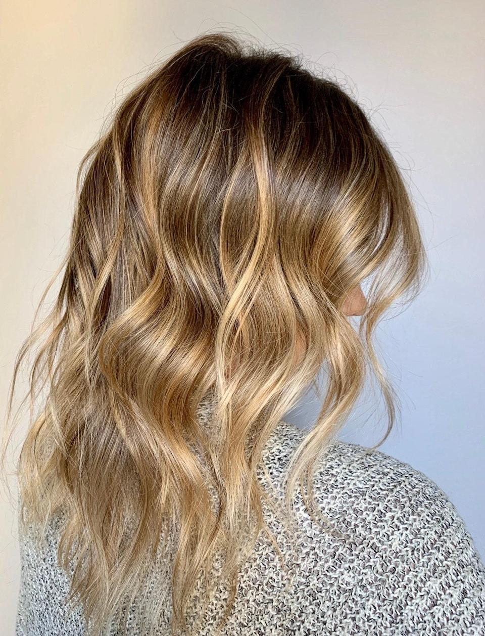 """""""In between blond and brown—bronde—is always beautiful for people who are naturally dark to medium brown,"""" says Grummel. """"Those with darker hair naturally pull warm because of underlying pigment in the hair, so to achieve a beautiful bronde, some warmth is necessary."""" She adds that this shade is great for those who don't want to commit to tons of touch-ups and is perfect for brunettes wanting to try blond for the first time."""