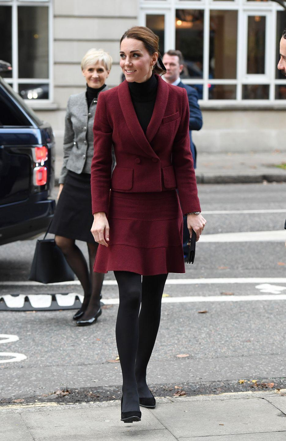 """<p>Kate paid a visit to University College London wearing a skirt and blazer by Paule Ka. She paired it with Tod's suede heels and a turtleneck. The Duchess actually recycled this ensemble: she <a href=""""https://twitter.com/WhatKateWore/status/1065250724542586881"""" rel=""""nofollow noopener"""" target=""""_blank"""" data-ylk=""""slk:has sported the Paule Ka skirted suit on at least two previous occasions"""" class=""""link rapid-noclick-resp"""">has sported the Paule Ka skirted suit on at least two previous occasions</a>.</p>"""