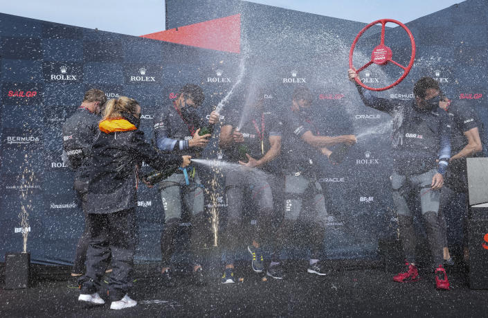 In this photo provided by SailGP, the Britain SailGP Team presented by INEOS, helmed by Sir Ben Ainslie, celebrate after winning the final race on race Day 2 of the Bermuda SailGP event in Hamilton, Bermuda, Sunday, April 25, 2021. (Thomas Lovelock/SailGP via AP)