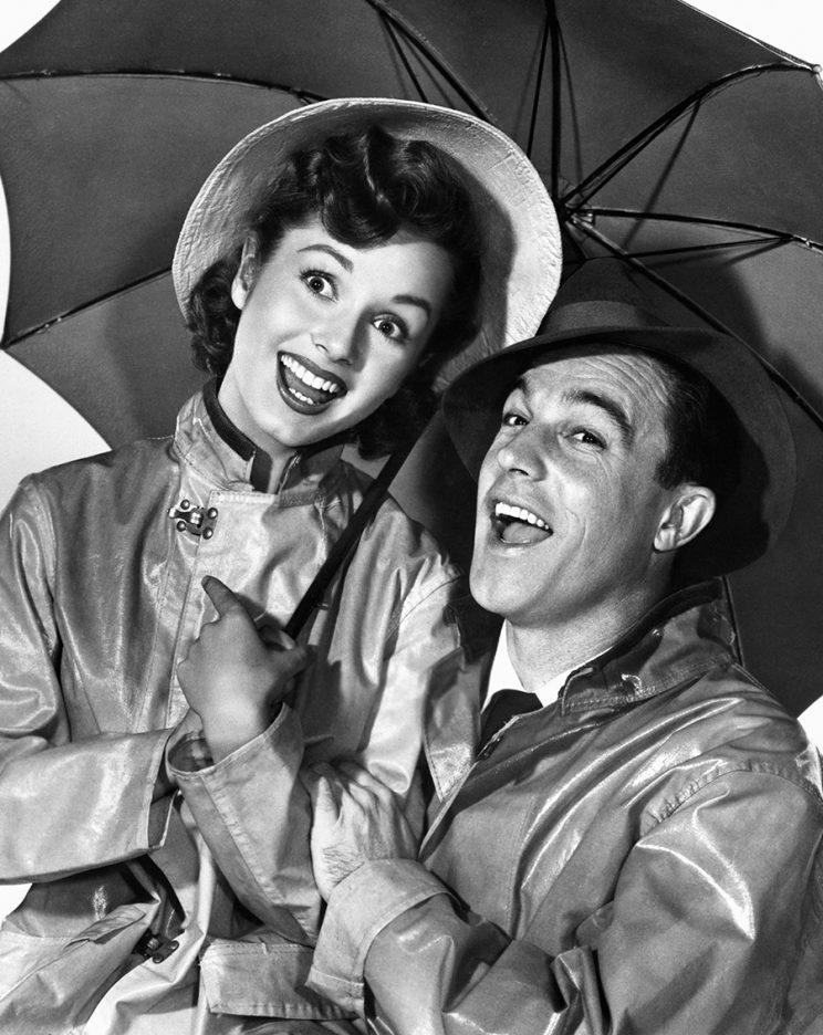 Debbie Reynolds and gene Kelly in the 1952 movie 'Singin' in the Rain.' (Photo: Getty Images)