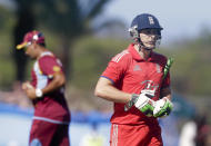 England's Luke Wright leaves the field after he was caught by West Indies' Darren Sammy during their first one-day international cricket match at the Sir Vivian Richards Cricket Ground in St. John's, Antigua, Friday, Feb. 28, 2014. (AP Photo/Ricardo Mazalan)