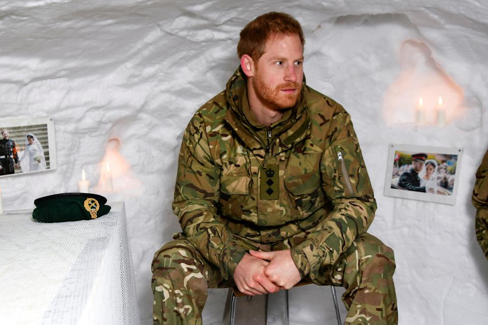 Britain's Prince Harry, Captain General Royal Marines, sits in a snow cave decorated with candles and his wedding photos, during Exercise Clockwork, celebrating 50 years of cold weather military training at Bardufoss Air Station, Norway February 14, 2019. NTB Scanpix/Rune Stoltz Bertinussen via REUTERS ATTENTION EDITORS - THIS IMAGE WAS PROVIDED BY A THIRD PARTY. NORWAY OUT