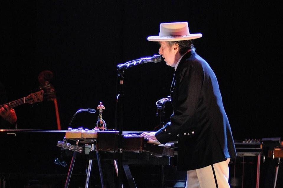 "Singer-songwriter <strong>Bob Dylan</strong> was raised in <a href=""https://www.rollingstone.com/music/music-news/bob-dylan-superfan-hibbing-minnesota-858270/"" rel=""nofollow noopener"" target=""_blank"" data-ylk=""slk:Hibbing, Minnesota"" class=""link rapid-noclick-resp"">Hibbing, Minnesota</a>, where he began forming his own bands and performing at local cafes in high school. The young talent, who was born Robert Zimmerman, eventually took on his <em>nom de guerre</em> while attending the University of Minnesota. ""He was that weird kid from Hibbing that a lot of people didn't understand, but he's more Hibbing than a lot of people give him credit for,"" <strong>Aaron Brown</strong>, who helped run the Dylan Days Festival in Hibbing, told <a href=""https://www.mprnews.org/story/2016/12/09/bob-dylans-hometown-of-hibbing-struggles-with-how-to-honor-its-most-famous-son"" rel=""nofollow noopener"" target=""_blank"" data-ylk=""slk:MPR News"" class=""link rapid-noclick-resp"">MPR News</a><em>.</em> Dylan has found ways to honor his hometown throughout his career. His 1965 album, <a href=""https://www.songfacts.com/facts/bob-dylan/highway-61-revisited"" rel=""nofollow noopener"" target=""_blank"" data-ylk=""slk:Highway 61 Revisited"" class=""link rapid-noclick-resp""><i>Highway 61 Revisited</i></a>, for example, was named after the road that took Dylan from Minnesota to those southern cities known for their musical roots, like Memphis, New Orleans, and the Delta blues area of Mississippi."