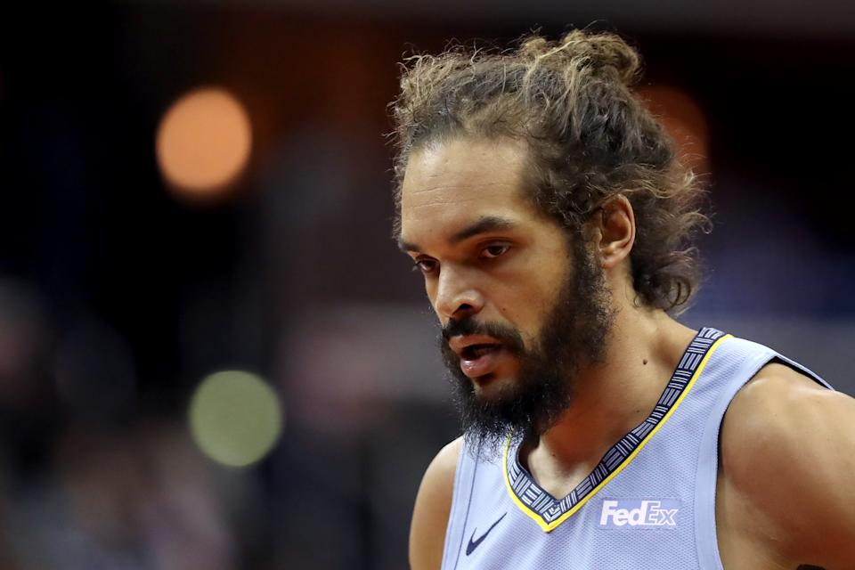Joakim Noah #55 of the Memphis Grizzlies looks on in the first half against the Washington Wizards at Capital One Arena on March 16, 2019 in Washington, DC. NOTE TO USER: User expressly acknowledges and agrees that, by downloading and or using this photograph, User is consenting to the terms and conditions of the Getty Images License Agreement. (Photo by Rob Carr/Getty Images)