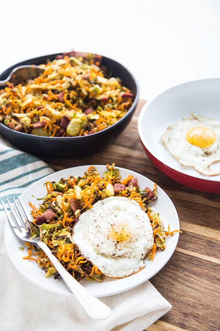 """<p>Brussels sprouts for breakfast, anyone? This twist on a classic hash also counts towards your veggie intake.</p><p><strong>Get the recipe from <a href=""""https://www.thepioneerwoman.com/food-cooking/recipes/a95894/roasted-ham-shredded-brussels-sprout-hash/"""" rel=""""nofollow noopener"""" target=""""_blank"""" data-ylk=""""slk:Natalie Perry"""" class=""""link rapid-noclick-resp"""">Natalie Perry</a>.</strong></p>"""