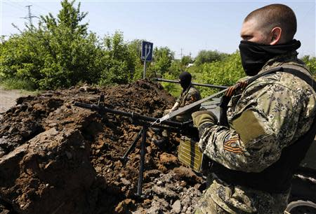 Pro Russian rebels man a position in eastern Ukraine