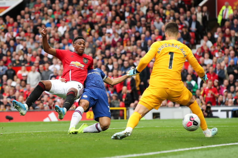 Anthony Martial makes it 2-0. (Photo by Matthew Ashton - AMA/Getty Images)