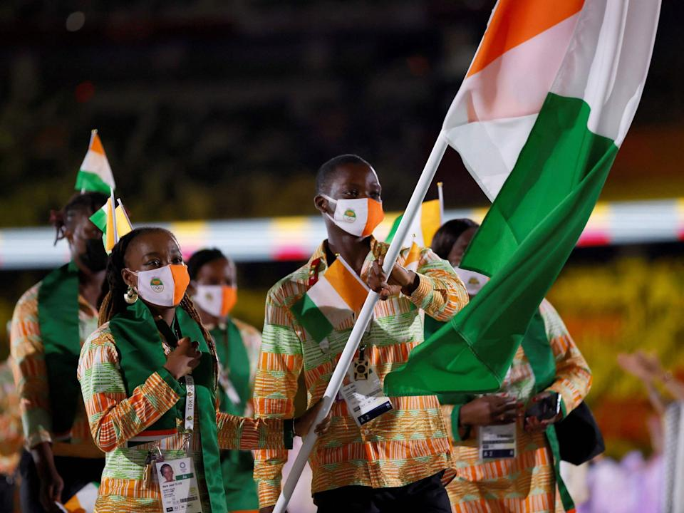 Athletes from Cote d'Ivoire make their entrance at the Summer Olympics.