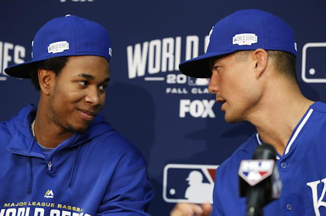 Kansas City Royals Yordano Ventura, left, translates for Jeremy Guthrie during a press conference before Game 1 of baseball's World Series against the San Francisco Giants Tuesday, Oct. 21, 2014, in Kansas City, Mo. (AP Photo/Orlin Wagner)