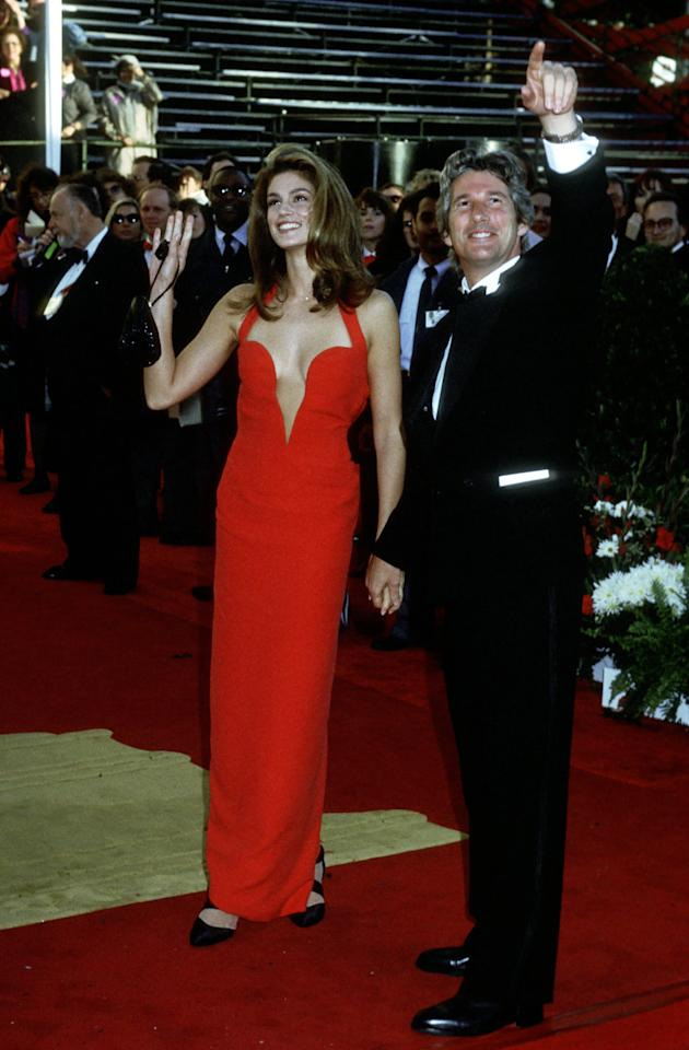 """<p>Cindy's memorable Versace number featured a sexy, halter-style bodice. The supermodel famously accompanied <a class=""""sugar-inline-link ga-track"""" title=""""Latest photos and news for Richard Gere"""" href=""""https://www.popsugar.com/Richard-Gere"""" target=""""_blank"""" data-ga-category=""""Related"""" data-ga-label=""""https://www.popsugar.com/Richard-Gere"""" data-ga-action=""""&lt;-related-&gt; Links"""">Richard Gere</a> to the award ceremony.</p>"""
