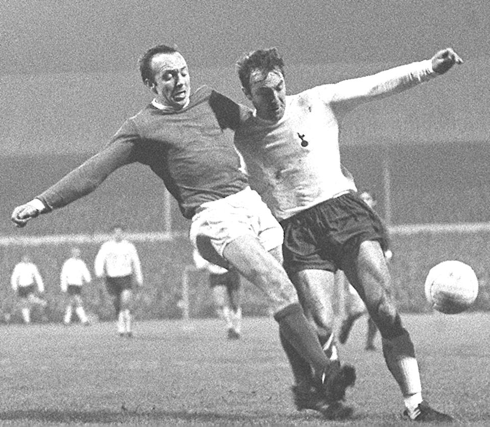 Manchester United's Nobby Stiles (left) and Tottenham Hotspur's Jimmy Greaves in a tussle for the ball during the First Division match at White Hart Lane, London. (Photo by PA Images via Getty Images)