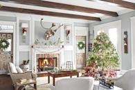 """<p>Holiday-appropriate plaid accents, like the throw on the ladder and the scarf on the caribou, add timeless charm, while vintage wrapping paper ups the nostalgia factor in this <a href=""""https://www.countryliving.com/home-design/house-tours/g3856/christmas-tennessee-house-tour/"""" rel=""""nofollow noopener"""" target=""""_blank"""" data-ylk=""""slk:Tennessee living room"""" class=""""link rapid-noclick-resp"""">Tennessee living room</a>.</p><p><strong><a class=""""link rapid-noclick-resp"""" href=""""https://www.amazon.com/Lavish-Home-Throw-Blanket-Cashmere-Like/dp/B00G90FAMI?tag=syn-yahoo-20&ascsubtag=%5Bartid%7C10050.g.1247%5Bsrc%7Cyahoo-us"""" rel=""""nofollow noopener"""" target=""""_blank"""" data-ylk=""""slk:SHOP THROW BLANKETS"""">SHOP THROW BLANKETS</a></strong></p>"""
