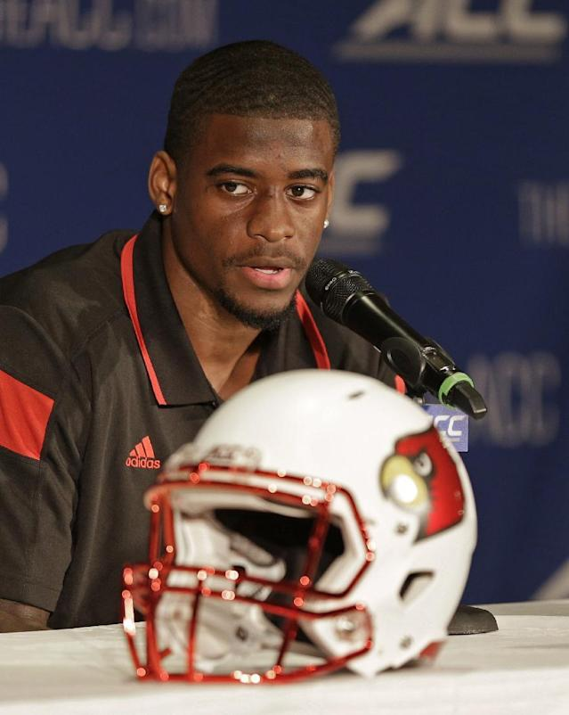 Louisville's Devante Parker answers a question during a news conference at the Atlantic Coast Conference Football kickoff in Greensboro, N.C., Sunday, July 20, 2014. (AP Photo/Chuck Burton)