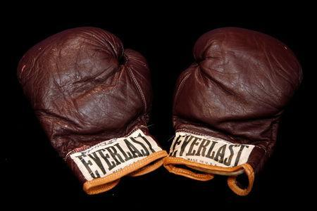 Muhammad Ali's fight worn gloves when he defeated Oscar Bonavena are displayed by Julien's Auctions in New York City, U.S., December 1, 2016. REUTERS/Brendan McDermid