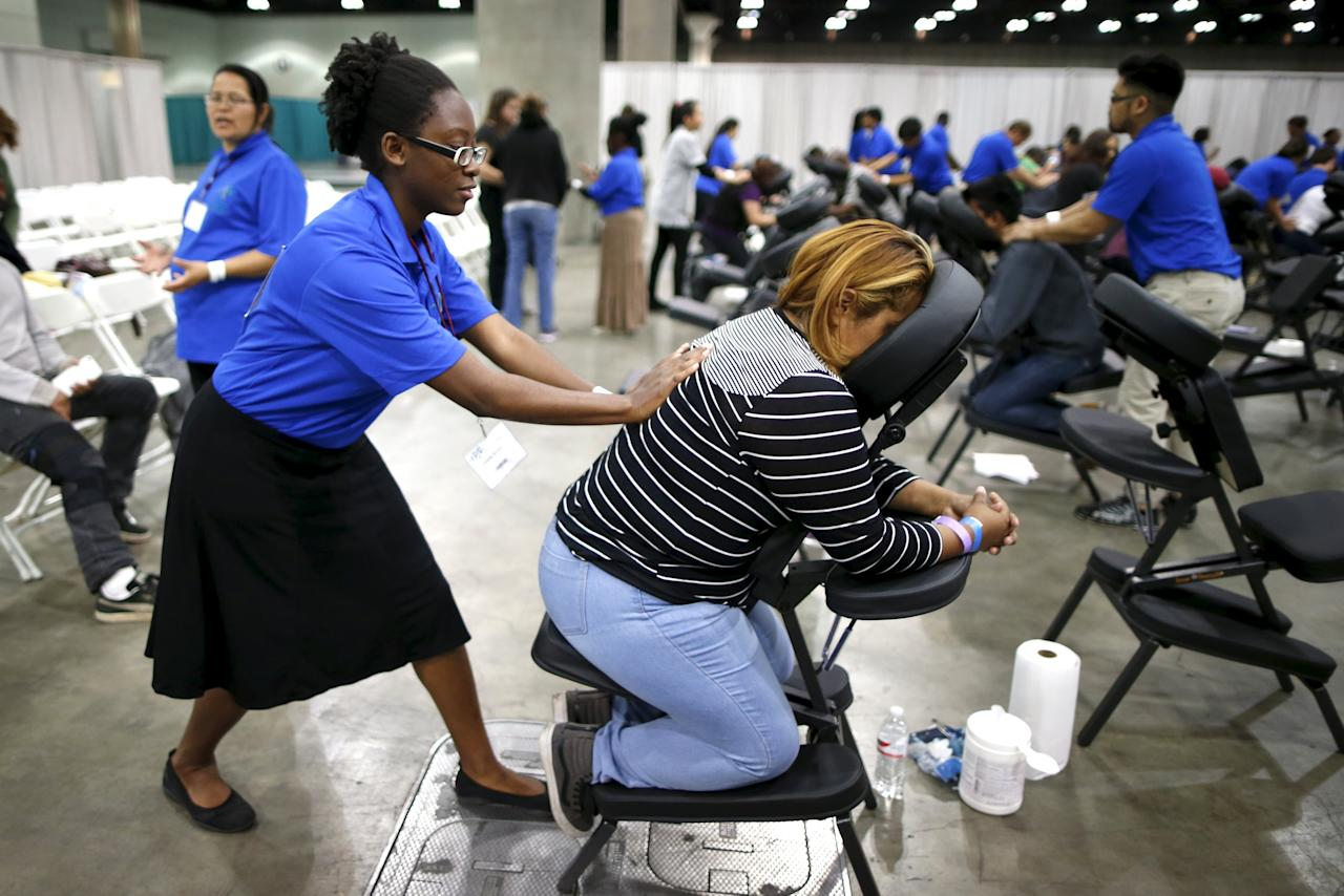 People receive massages at a free medical and dental health clinic in Los Angeles, California, U.S., April 27, 2016. REUTERS/Lucy Nicholson